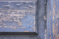 Old entrance wooden door with peeling blue paint stock photography
