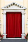 Old entree. Entree of an old Italian church with a red curtain Stock Photography
