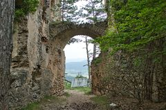 Old entry to the castle ruin. Old entry to a castle ruin arch travel knights slovakia landscape gentry tree tourist attraction hill historic tower stone nobility stock photos