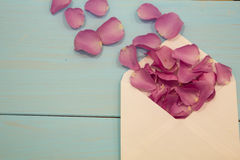 Old envelope with blank paper and dried rose petals Royalty Free Stock Photography