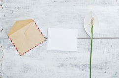 Old envelope and card with flower Royalty Free Stock Photo