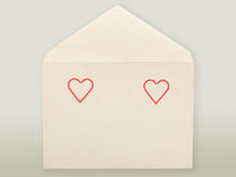Old envelope and hearts. Stock Photo