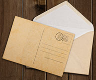 Old envelope and postcard. Royalty Free Stock Images