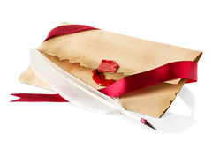 Old envelope, quill pen close-up Royalty Free Stock Images