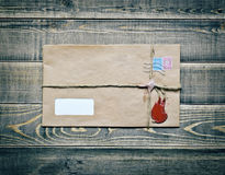 Old envelope on wooden table Royalty Free Stock Image
