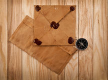 Old envelopes and compass Stock Images