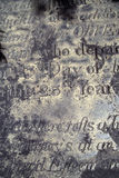 Old epitaph. An old distressed and eroded epitaph royalty free stock photos