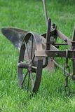 An old equestrian plow on green grass. The middle band of Russia. stock photo