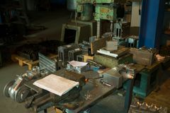 Old equiped metalworking workshop with obsolete tools. In low light Stock Image