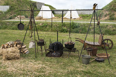 Old equipment for cooking on  camping. Old coocking equipment with tent outside on  camping Royalty Free Stock Image