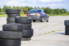 Old erased tires . Old erased tires heaped on concrete plates stock photo