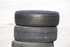 Old erased tires. Heaped on concrete plates stock photography