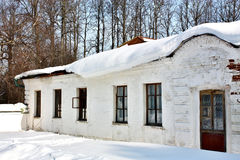 Old estate with snow on the roof Royalty Free Stock Image
