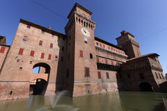 Old Estense Castle in Ferrara in Italy. Medieval moated castle with water Este dynasty in Ferrara in Italy Royalty Free Stock Images