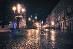 Old European city at night Stock Images