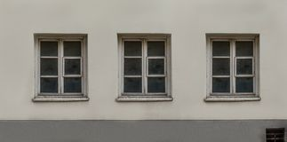 Old European classic building three windows facade. Restoration , renovation real estate royalty free stock photography