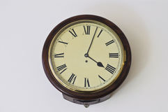 Old European classic clock with roman numbers at 4pm Stock Images