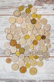 Old European Coins Collection. Old coins collection from European countries on wooden white background Royalty Free Stock Photos