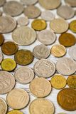 Old European Coins Collection. Old coins collection from European countries on wooden white background Stock Image