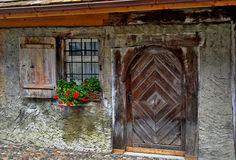 Old European door with flower box Stock Image