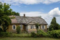Old European farmhouse. Old vintage farmhouse, windows with herb view over the farmhouse Royalty Free Stock Photography