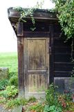 Old European Garden Shed with Vines Stock Photo
