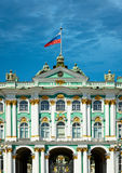 Old European palace with Russian flag Stock Photos