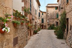 Old European street decorated with fresh flowers city of Valldemossa. Palma de Mallorca. Spain. Royalty Free Stock Photos