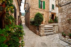 Old European street decorated with fresh flowers city of Valldemossa. Palma de Mallorca. Spain. Stock Photography