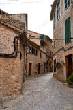 Old European street decorated with fresh flowers city of Valldemossa. Palma de Mallorca. Spain. Stock Images