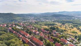 Old European town with green hills drone view from above stock photo