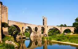 Old european town with medieval bridge over  river Royalty Free Stock Photography