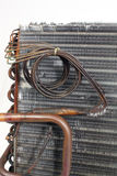 Old Evaporator Coil (14). A closeup of the side of an old A-frame evaporator coil taken from a 2.5-ton residential r22 straight capillary system where it Royalty Free Stock Photo
