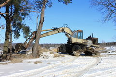 Old excavator. On winter road Royalty Free Stock Photography