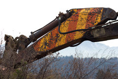 An old excavator arm. An Old Dirty Yellow Red excavator arm Stock Photos