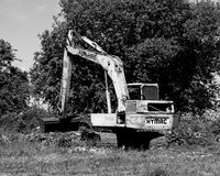 An Old Excavator on the Kennet and Avon Canal. An old Hymac excavator on the Kennet and Avon Canal, Wiltshire, England stock photos