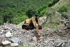 An old excavator left to rot on bequia Stock Images