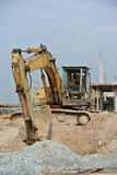 Old Excavator Machine for earthwork. SELANGOR, MALAYSIA – AUGUST 2014: Old Excavators machine excavate soil at construction site Stock Photography