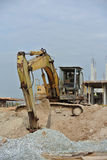 Old Excavator Machine for earthwork. SELANGOR, MALAYSIA – AUGUST 2014: Old Excavators machine excavate soil at construction site Royalty Free Stock Photos