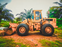 Old excavator in the middle of the Bush. Liberia, West Africa Royalty Free Stock Images