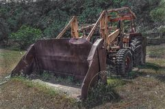 Old excavator in the mountains in the woods, Turkey stock photo