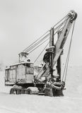 Old excavator in the winter close-up Stock Photos