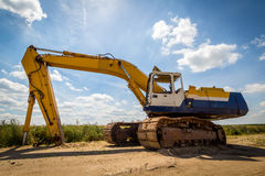 Old Excavator. Old yellow Excavator at Construction Site. Wide angle view Stock Photography