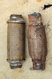 Old exhaust pipe. Background brown Stock Images