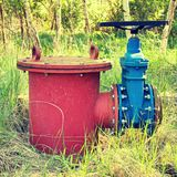 Old expansion pipe of drink water pipes joined with new blue valve and new blue joint members. New dump valve.  Extreme kind of co Stock Photos