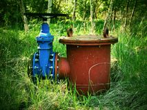 Old expansion pipe of drink water pipes joined with new blue valve and new blue joint members. New dump valve.  Extreme kind of co. Old expansion pipe of drink Royalty Free Stock Photo