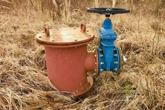 Old expansion pipe of drink water pipes joined with new blue valve and new blue joint members. New dump valve. Royalty Free Stock Photo
