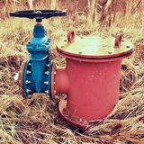 Old expansion pipe of drink water pipes joined with new blue valve and new blue joint members. New dump valve. Stock Photos