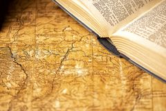 Old expedition map and book. Old expedition map with an oldfashioned open book stock photos