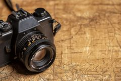 Old expedition map and camera. Old expedition map and vintage manual photo camera with lens royalty free stock images